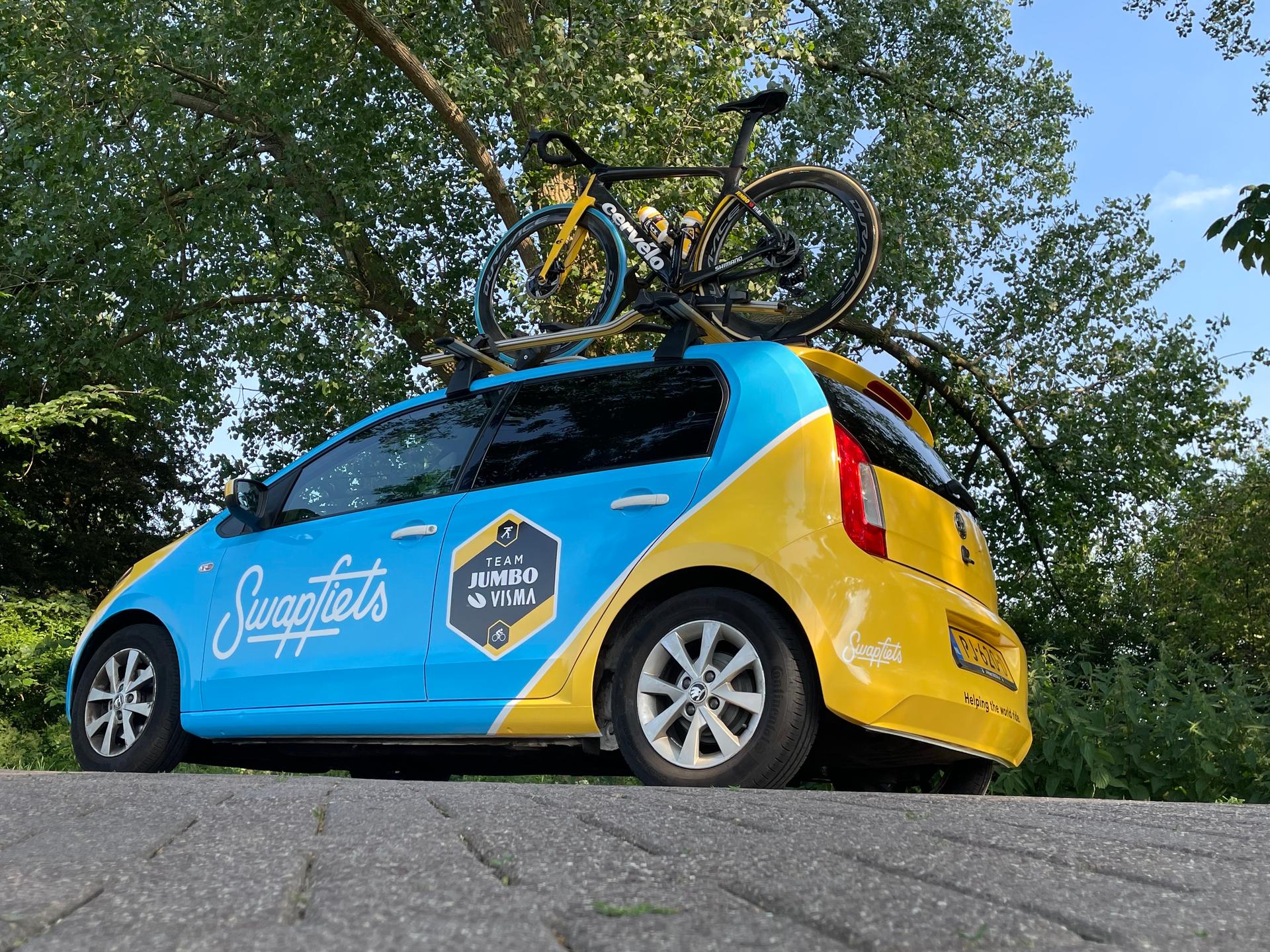 Tour de france swapfiets ploegleiderswagen