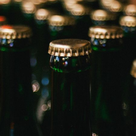 Bierflessen bieromzet supermarkthouder tevreden