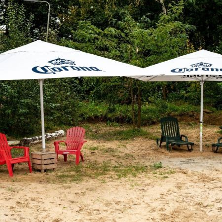 Parasol corona plastic stoelen terras