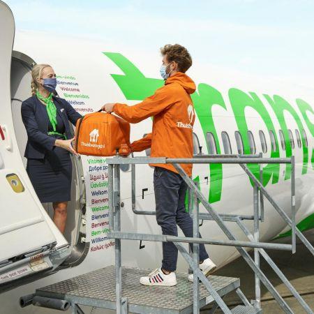 Thuisbezorgd vliegtuig in flight transavia