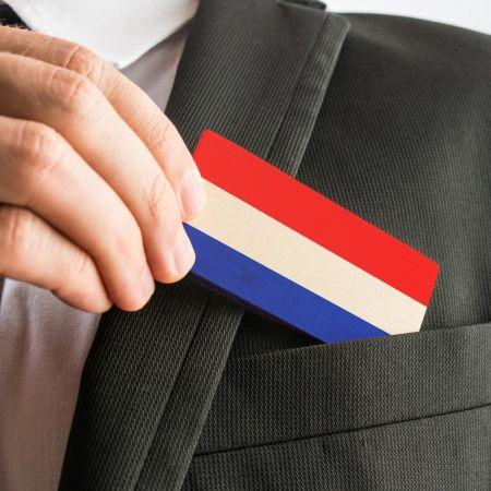 Zakenman kaartje vlag nederland
